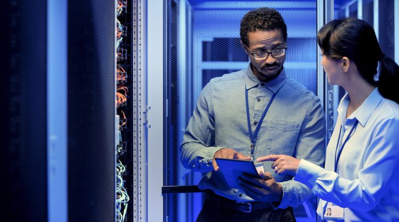 IT engineers using digital tablet