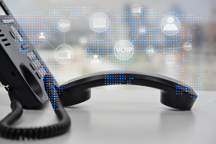 IP Phone double exposure with blue LED world map and business icon of VOIP human and  for communication concept